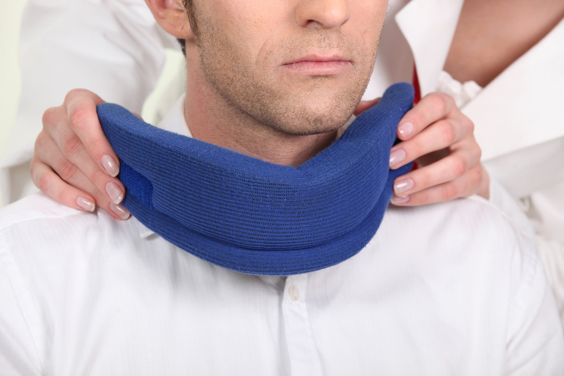 doctor puts neck support brace